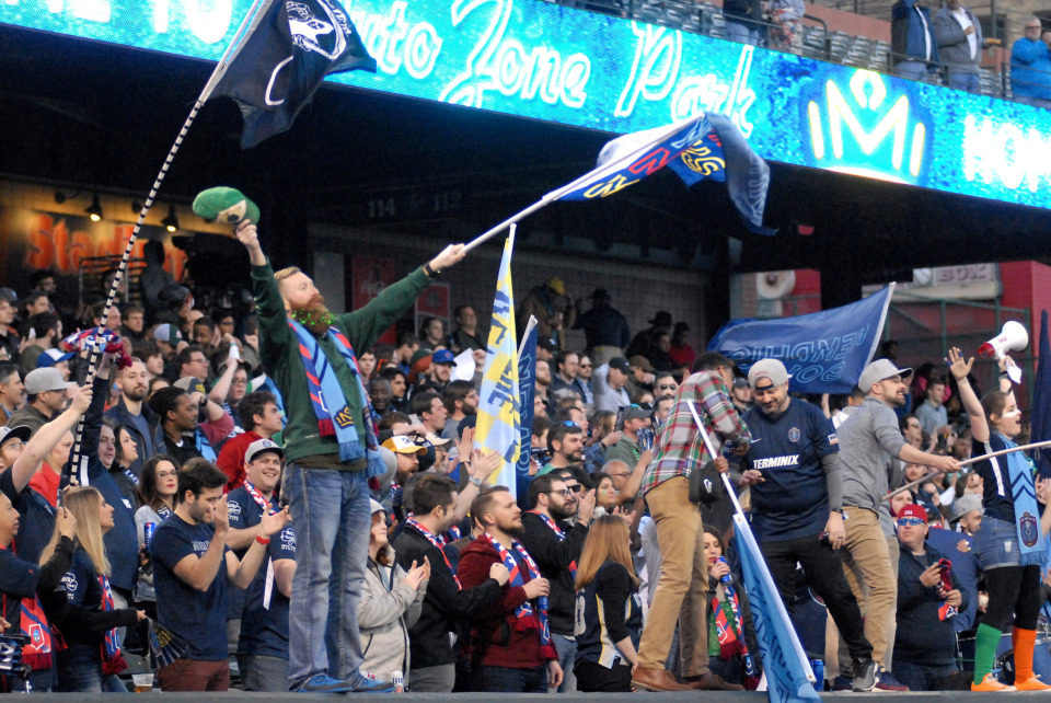 <strong>Bluff City Mafia fans celebrate the start of a match between Memphis 901 FC and Loudoun United on Saturday, March 16, 2019, in AutoZone Park in Memphis. The match ended in a 1-1 tie.</strong> (Stan Carroll/Special to The Daily Memphian)