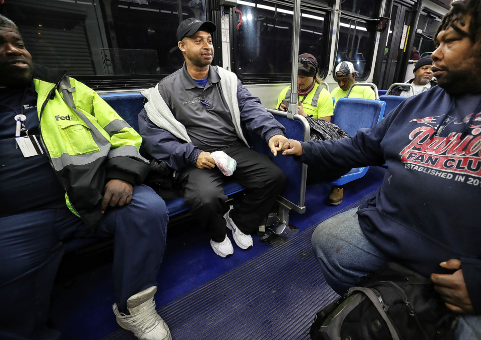 <strong>Sammie Hunter (left) greets his friend Sean Huff during their morning commute on the #30 Brooks Peebles route. Hunter, who lives in East Memphis and works at Methodist South Hospital, commutes almost four hours a day on the bus.</strong>&nbsp;<strong>&ldquo;When you're depending solely on public transportation, that's our right to have sufficient transportation,&rdquo; said Hunter, who is also a co-chair of the Memphis Bus Riders Union. &ldquo;It's a privilege and right we have to sufficient transportation.&rdquo;&nbsp;</strong>(Jim Weber/Daily Memphian)
