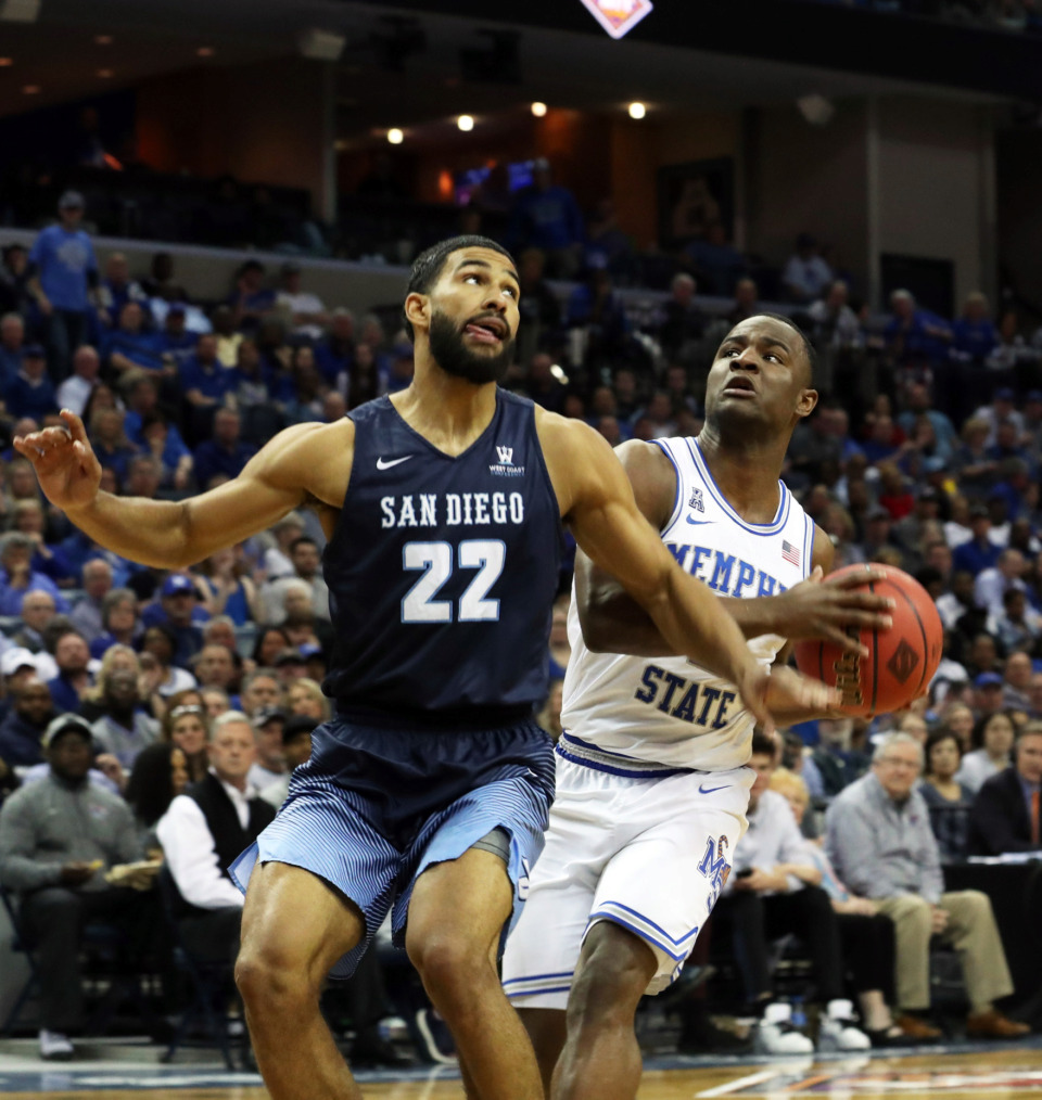 <strong>Memphis Tigers' Alex Lomax (2) goes up for a basket against San Diego's Isaiah Wright.</strong> (Karen Pulfer Focht/Special to the Daily Memphian)