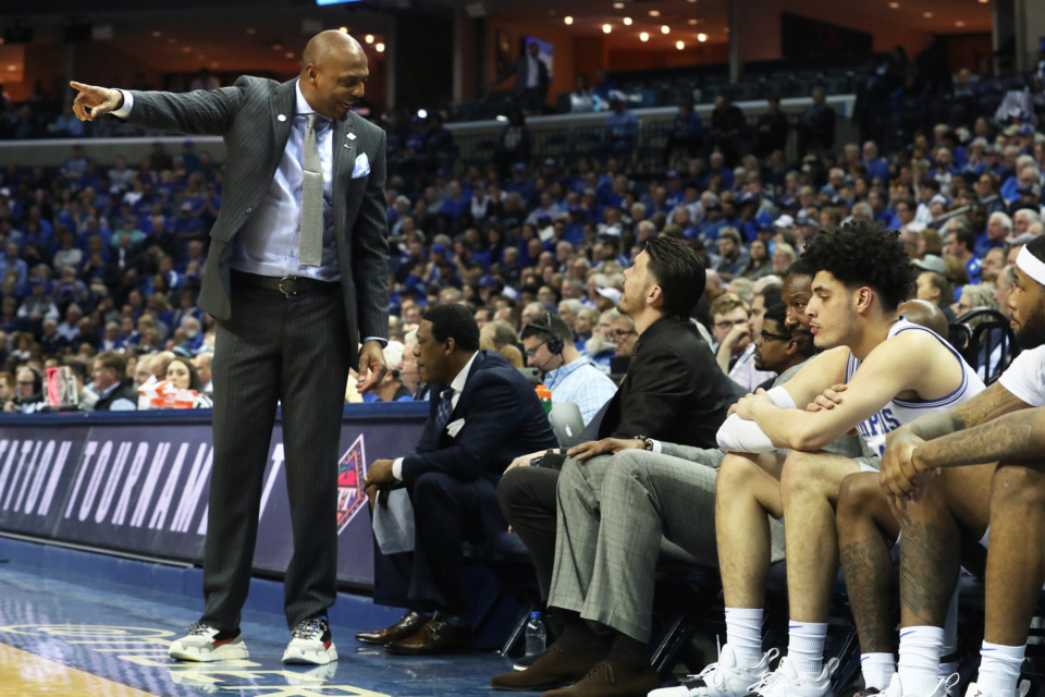 <strong>Coach Penny Hardaway talks to one of his assistant coaches, Mike Miller, during the game at FedExForum.</strong> (Karen Pulfer Focht/Special to the Daily Memphian)
