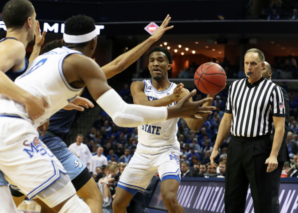 <strong>Memphis Tiger Jeremiah Martin (3) passes the ball during the second half of Tuesday's game against San Diego at FedExForum. The Tigers won 74-60 and advance to the next round of the National Invitation Tournament.</strong> (Karen Pulfer Focht/Special to the Daily Memphian)