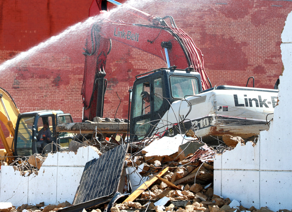 <strong>Bryan Payne, an employee at Payne &amp; Son Excavation Contractors, uses a crane to demolish what is left of the iconic Plush Club near the west end of Beale St. in downtown Memphis.</strong> (Houston Cofield/Daily Memphian)