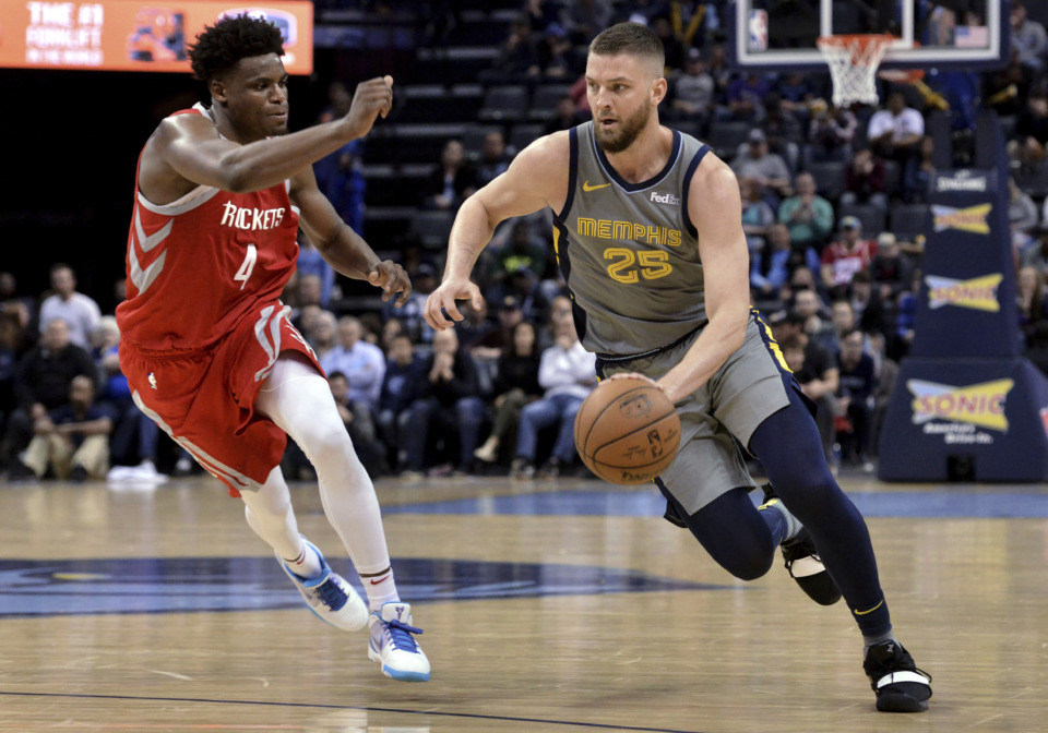 <strong>Memphis Grizzlies forward Chandler Parsons (25) drives against Houston Rockets forward Danuel House Jr. (4) in overtime of an NBA basketball game Wednesday, March 20, 2019, in Memphis, Tenn.</strong> (AP Photo/Brandon Dill)