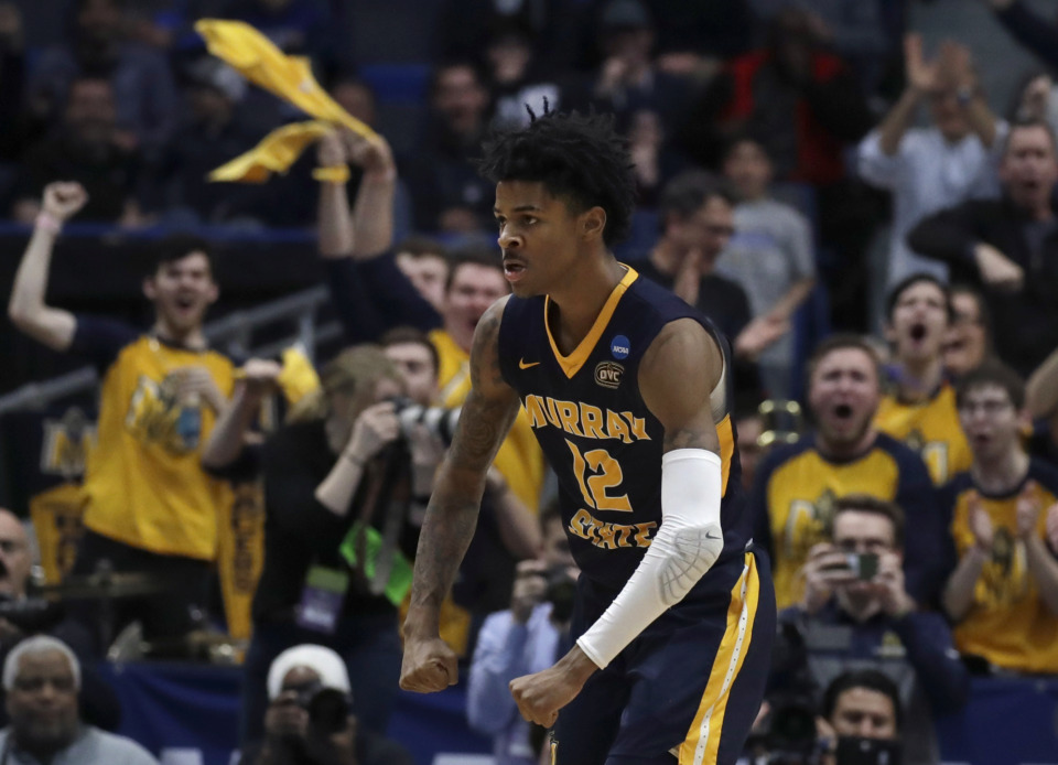 <span><strong>Fans cheer as Murray State's Ja Morant (12) celebrates a basket during the second half of a first round men's college basketball game against Marquette in the NCAA Tournament, Thursday, March 21, 2019, in Hartford, Conn.</strong> (AP Photo/Elise Amendola)</span>
