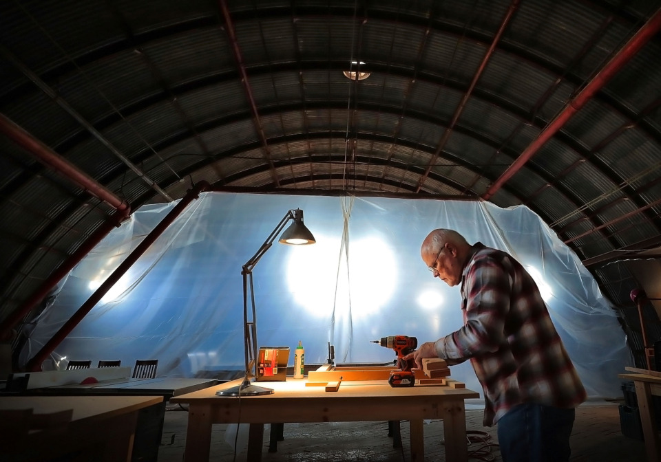<strong>Michael Brown works on tables for the new Grind City Brewing Co. which is renovating an old furniture manufacturing plant in an economically distressed industrial and residential area north of Uptown.</strong> (Jim Weber/Daily Memphian)
