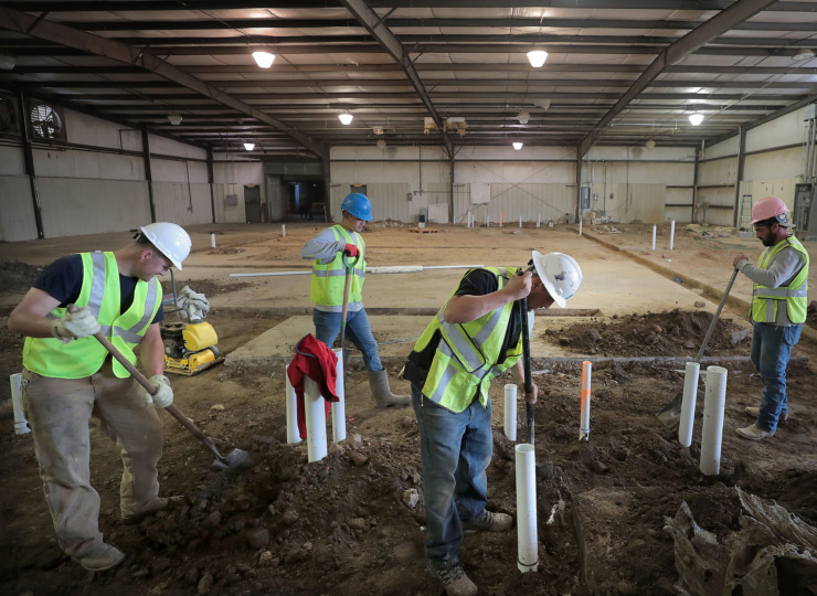 <strong>Construction workers Dustin Roberts, left, Hugo Dominguez, Rodolpho Dominguez and Joseph Cirrito work on drainge for phase one of the new Grind City Brewing Co.</strong> (Jim Weber/Daily Memphian)
