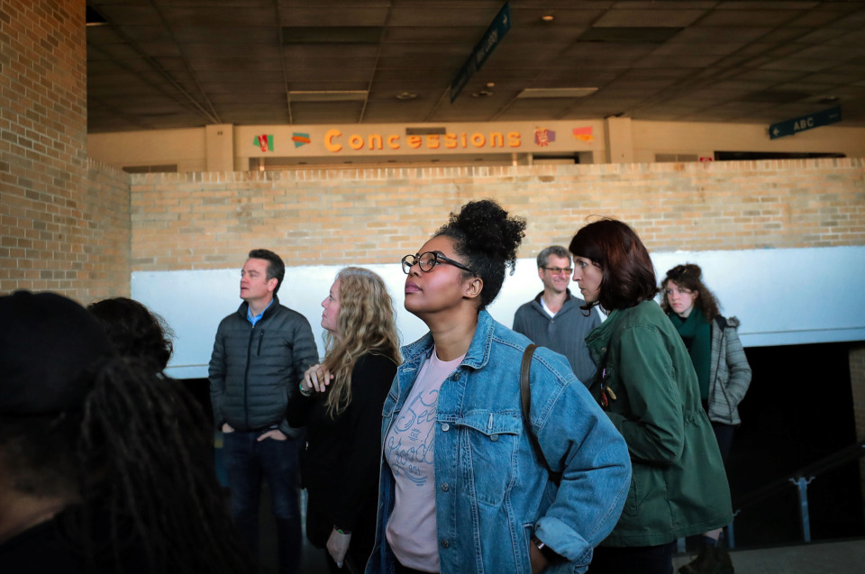 <strong>Sheree Stubblefield (center) with the Cooper Young Community Association looks around one of the entryways with other interested Memphians during a tour of the Mid-South Coliseum on March 22, 2019, conducted by the Coliseum Coalition to educate members of the public on the site's history, present condition and the possibilities of development in the future.</strong> (Jim Weber/Daily Memphian)