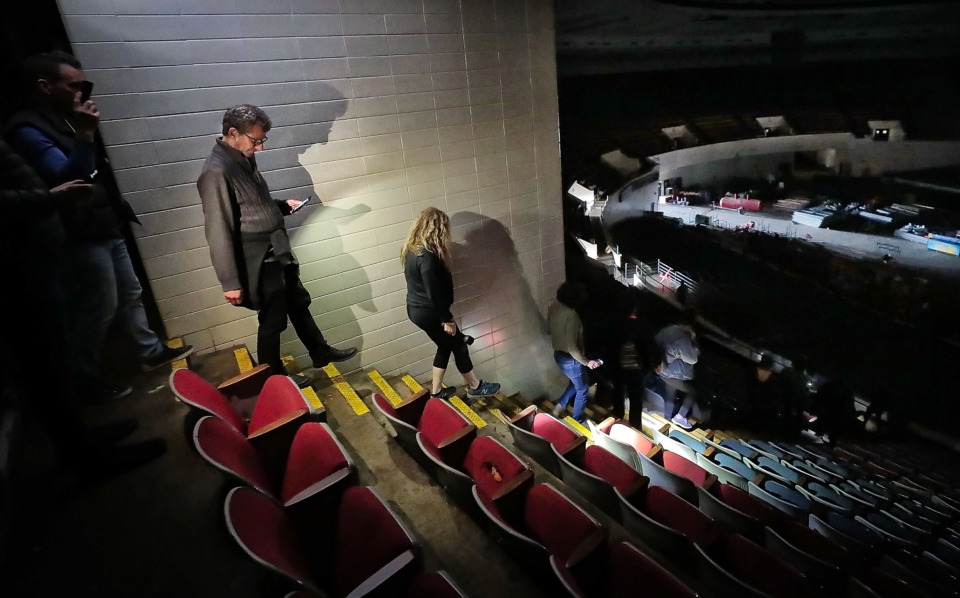 <strong>Cam McCaa (left) and other interested Memphians decend from the press box area during a tour of the Mid-South Coliseum on March 22, 2019, conducted by the Coliseum Coalition to educate members of the public on the site's history, present condition and the possibilities of development in the future.</strong> (Jim Weber/Daily Memphian)