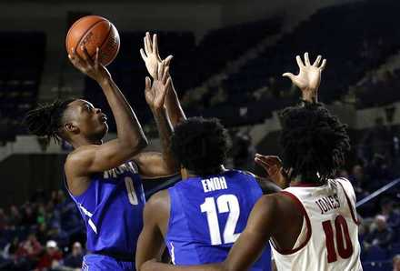 <strong>Memphis forward Kyvon Davenport (left, in last year's Veterans Classic tournament in Annapolis, Md.) led the Tigers last season with eight double-doubles as Memphis finished 21-13.</strong><span> (Patrick Semansky/Associated Press file)</span>