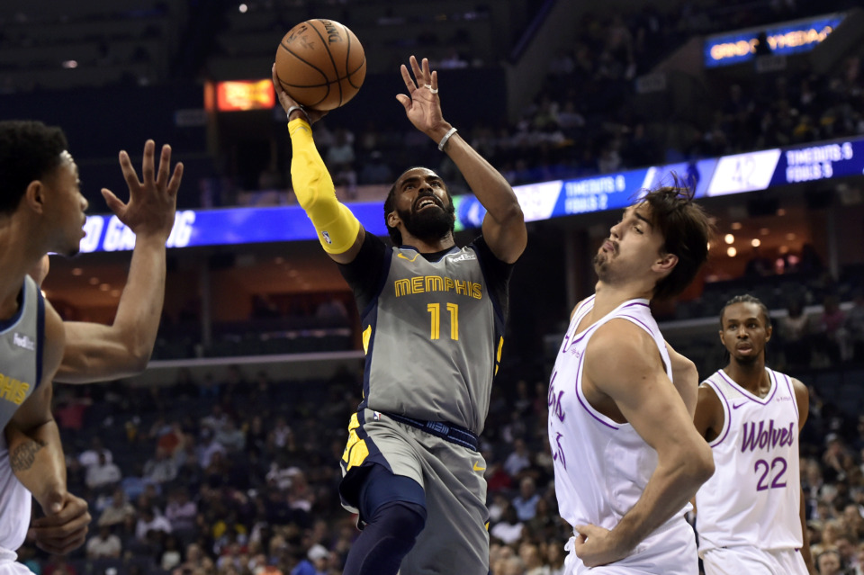<span><strong>Memphis Grizzlies guard Mike Conley (11) shoots against Minnesota Timberwolves forward Dario Saric in the first half of an NBA basketball game Saturday, March 23, 2019, in Memphis, Tenn.</strong> (AP Photo/Brandon Dill)</span>