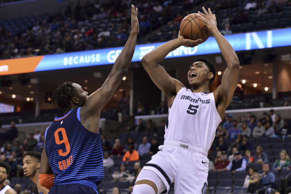 <span><strong>Memphis Grizzlies forward Bruno Caboclo (5) shoots against Oklahoma City Thunder forward Jerami Grant (9) during the first half of an NBA basketball game Monday, March 25, 2019, in Memphis, Tenn.</strong> (AP Photo/Brandon Dill)</span>