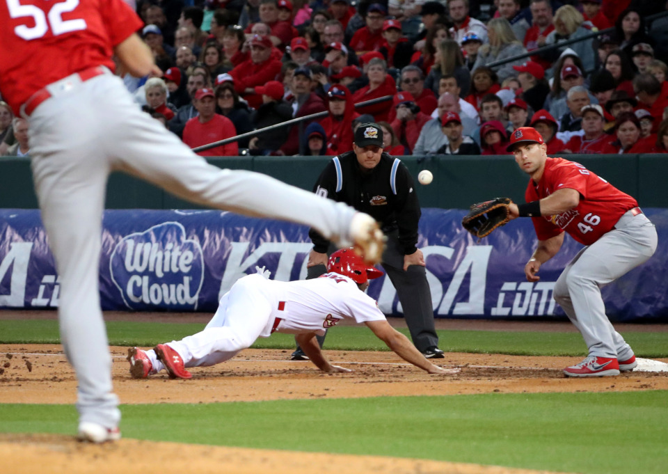 <strong>A St. Louis Cardinals pitcher slings the ball toward first baseman Paul Goldschmidt (46) to try and get a Memphis Redbirds runner out during the Battle of the Birds game Monday, March 25, 2019, at AutoZone Park.</strong> (Houston Cofield/Daily Memphian)