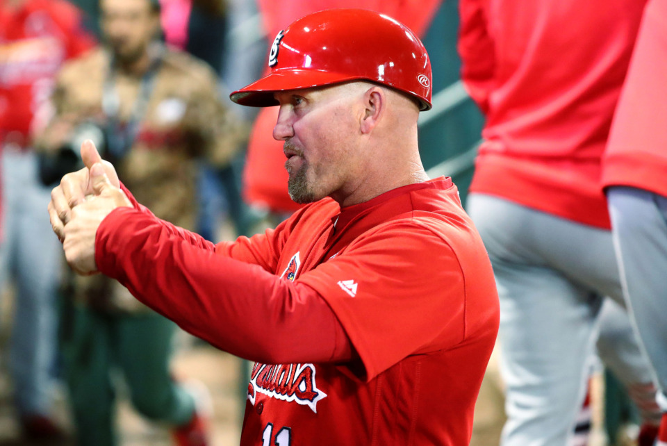 "<strong>St. Louis Cardinals first base coach Richard Keith ""Stubby"" Clapp (11) talks to one of his players before they walk to the plate during the Battle of the Birds game Monday, March 25, 2019. Clapp was the Redbirds' 2018 manager before joining the Cardinals' staff.</strong> (Houston Cofield/Daily Memphian)"