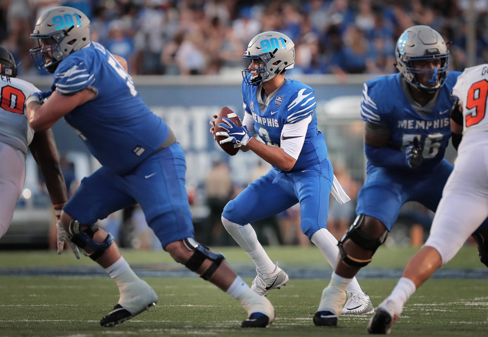 <strong>University of Memphis quarterback Brady White (center) looks for an open receiver during the Tigers' game against the Mercer Bears at Liberty Bowl Memorial Stadium on September 1, 2018. White said Tuesday he remembers watching Johnny Manziel play college football and wishes him the best with the Memphis Express.&nbsp;</strong>(Jim Weber/Daily Memphian file)