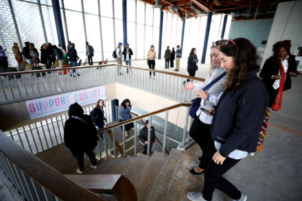 <strong>Megan McConville (right), a consultant with the Robert Wood Foundation, and Amber Genet (left), employee at the Ohio & Erie Canalway Coalition, discuss the various development possibilities for the Cossitt Library in Downtown Memphis.</strong> (Houston Cofield/Daily Memphian)