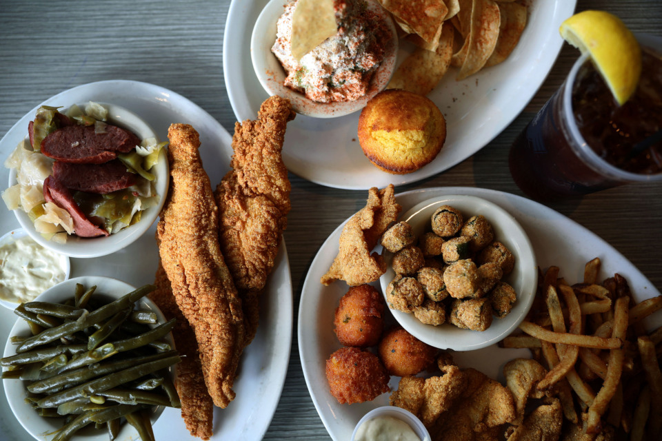 <strong>Thin and crispy catfish, fried okra and smoked catfish dip are all popular picks on Soul Fish's menu.&nbsp;The catfish is dredged in cornmeal mix and lightly fried.</strong> (Houston Cofield/Daily Memphian)