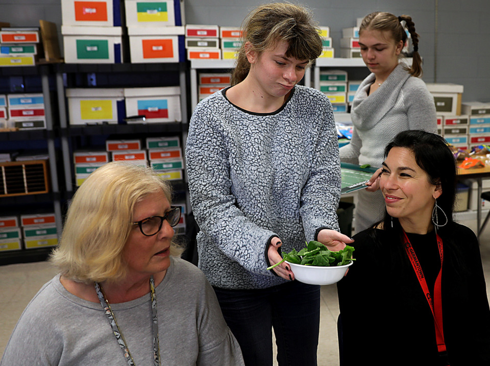 <strong>Heather Barrella and Kaitlyn Barnette bring out the first course of food to Leigh Ellis (right) and Marilyn Abplanalp (left) Wednesday, March 27 during a practice run for Mustang Caf&eacute;, an extension of the special education program at Houston High School that teaches the students how to work in a restaurant.</strong> (Patrick Lantrip/Daily Memphian)