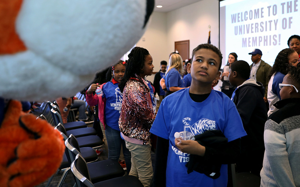 <strong>Jayden Davis didn't quite know what to think of University of Memphis mascot Pouncer during a Friday, March 29, visit to the campus by a group of fourth- and fifth-graders from several area schools, including Davis' Downtown Elementary.</strong> (Patrick Lantrip/Daily Memphian)