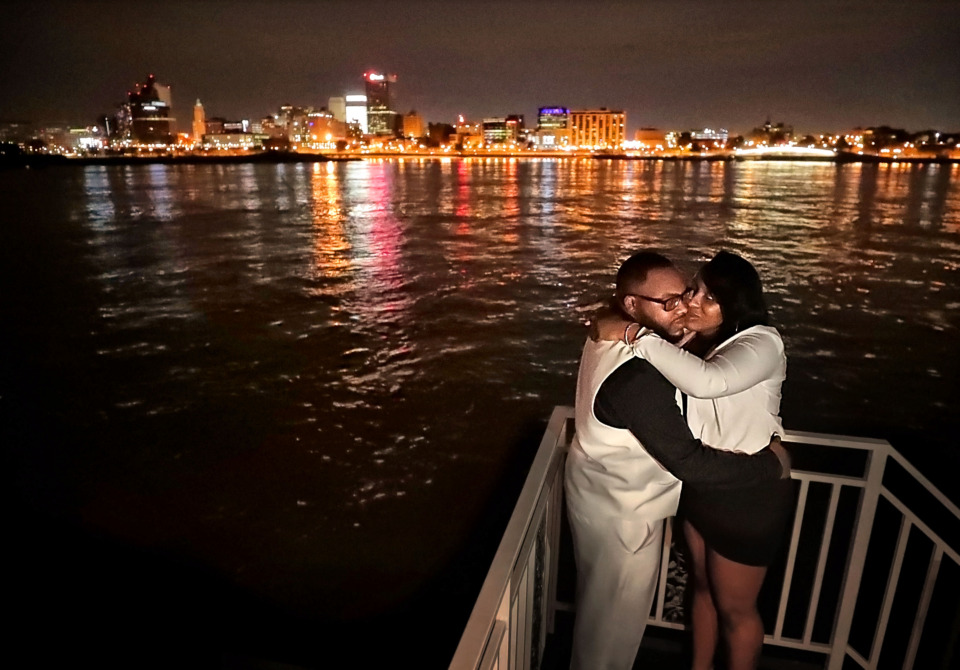 <strong>Cedric Leflore and Shadonna Stapleton of Clarksdale, Mississippi, cuddle on the deck during a dinner cruise aboard the Memphis Queen III on Friday, March 29. The two-decked sternwheeler is part of the Memphis Riverboats Inc. fleet that has been conducting tours on the Mississippi since the 1960s. Steamboats were a large part of the history of Memphis, making the Bluff City a transportation hub well before FedEx and Interstate 40.</strong> (Jim Weber/Daily Memphian)