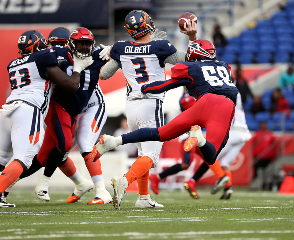 <strong>Orlando Apollos quarterback Garrett Gilbert (3) gets hit as he throws the ball, resulting in an interception for the Memphis Express during&nbsp;a Saturday, March 30, 2019, game against the Orlando Apollos at Liberty Bowl Stadium in Memphis.</strong> (Patrick Lantrip/Daily Memphian)