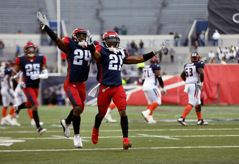 <strong>Charles James II (24) and Terrell Bonds (21) celebrate after a big interception during&nbsp;a Saturday, March 30, 2019, game against the Orlando Apollos at Liberty Bowl Stadium in Memphis.</strong> (Patrick Lantrip/Daily Memphian)