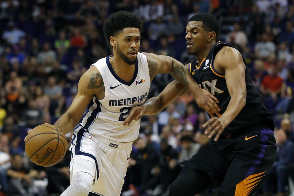 <strong>Memphis Grizzlies guard Tyler Dorsey (left) drives on Phoenix Suns guard De'Anthony Melton in the first half during an NBA game on Saturday, March 30, 2019, in Phoenix.</strong> (AP Photo/Rick Scuteri)