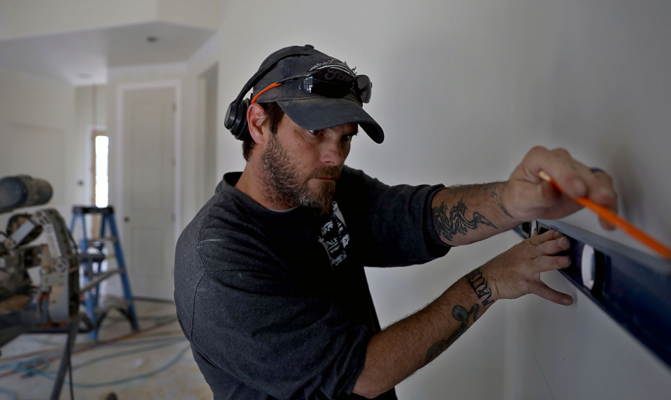 <strong>Bill Shennan and his company All-Trim Inc. put the finishing touches on a new house in the Winstead Farms subdivision of Lakeland on Friday, March 29, 2019.</strong> (Patrick Lantrip/Daily Memphian)