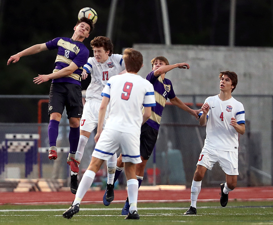 <strong>Christian Brothers High School senior midfielder Bergin Kranz (10) leaps up to land a header during a match against MUS on Friday, March 29, 2019. The Brothers (4-0) gained confidence during a preseason trip to Brazil.</strong>&nbsp;(Patrick Lantrip/Daily Memphian)