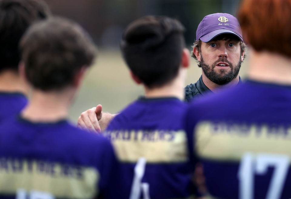 "<strong>CBHS men&rsquo;s soccer coach Nick Glaser goes over some halftime adjustments with his team on way to a 1-0 victory over MUS on March 29, 2019. Glaser says travel like the team's recent trip to Brazil is ""a good experience to help them grow up.""</strong> (Patrick Lantrip/Daily Memphian)"