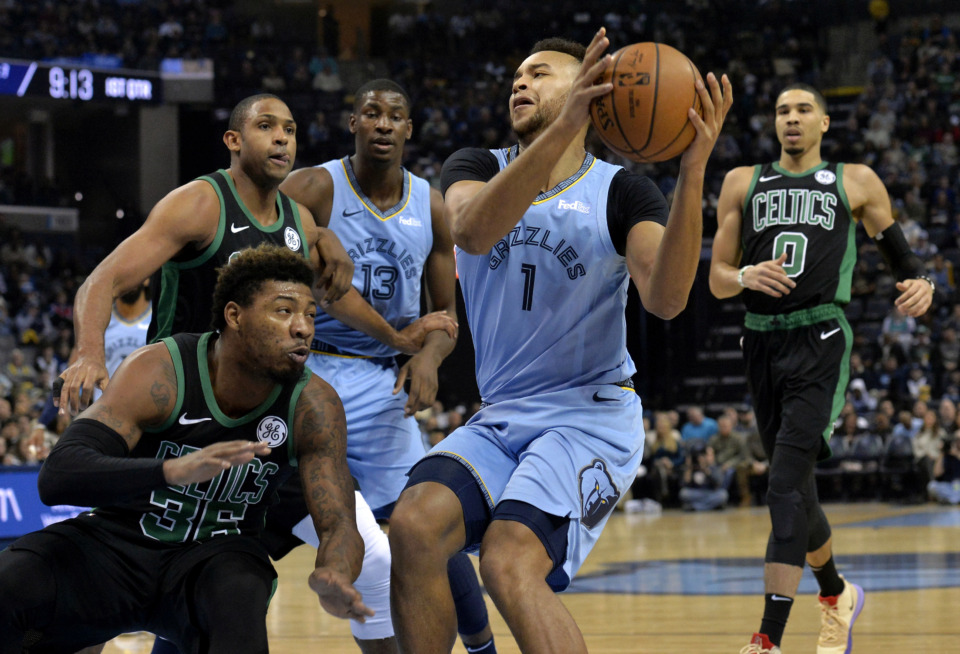 <span><strong>Memphis Grizzlies forward Kyle Anderson (1) drives against Boston Celtics guard Marcus Smart (36) as Celtics center Al Horford, left, Grizzlies forward Jaren Jackson Jr. (13), and Celtics forward Jayson Tatum (0) move for position during the first half of an NBA basketball game Saturday, Dec. 29, 2018, in Memphis, Tenn.</strong> (AP Photo/Brandon Dill)</span>