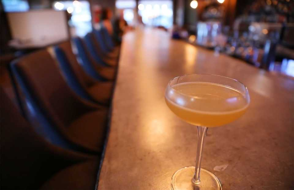 <strong>The Final Word is one of P.O. Press Public House and Provisions' signature cocktails.</strong> <strong>It's bourbon infused with dried magnolia flowers, mixed with Chartreuse and Solerno, a blood orange liqueur.</strong> (Patrick Lantrip/Daily Memphian)