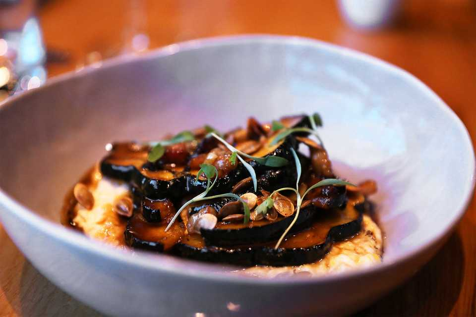 <strong>Corn mash with cheek bacon, mascarpone cream and tallow-roasted pepitas and topped with onion-infused oil.</strong>&nbsp;(Patrick Lantrip/Daily Memphian)