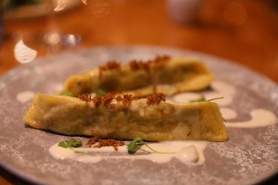 <strong>Agnolotti with braised pork shoulder, leeks, garlic, and toasted fennel seeds tossed in sage, brown butter and cornbread panna gratta.</strong> (Patrick Lantrip/Daily Memphian)
