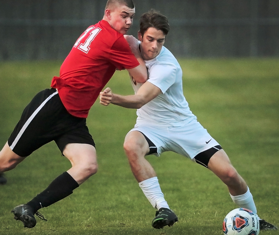 <strong>ECS soccer standout Carson Gagnon (right) wrestles control of the ball from Nathan Dreher (11) from Houston during a game on April 2, 2019, at Houston Middle School. ECS soccer is a family sport for the Gagnon brothers, with the oldest, Chandler, now an assistant coach, Carson a junior and Cameron a freshman.</strong> (Jim Weber/Daily Memphian)