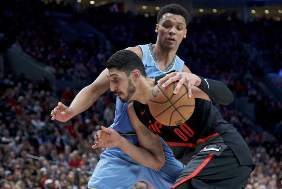 <strong>Portland Trail Blazers center Enes Kanter, front, drives to the basket past Memphis Grizzlies forward Bruno Caboclo during the second half of an NBA basketball game in Portland, Ore., Wednesday, April 3, 2019.</strong> (AP Photo/Craig Mitchelldyer)