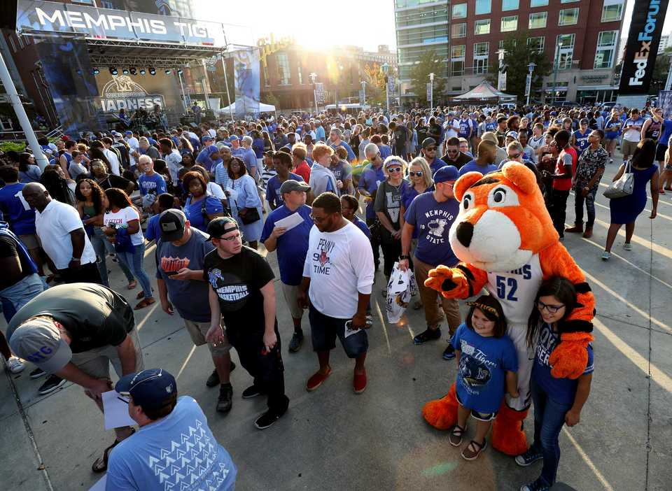 <strong>Tiger mascot Pouncer mingled with fans who flooded the front plaza of FedExForum before Memphis Madness.</strong> (Houston Cofield/Daily Memphian)