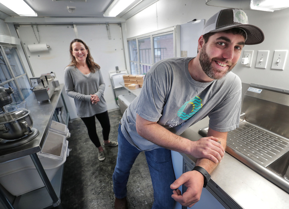 "<strong>A new treat shop called Happy Glaze Donuts is opening this spring in Germantown, offering a dream job for Jake Gaines (right), who will act as ""Chief Donut Officer"" for the business being opened by sister-in-law Krissy Johnson and her husband, Tim.</strong> (Jim Weber/Daily Memphian)"