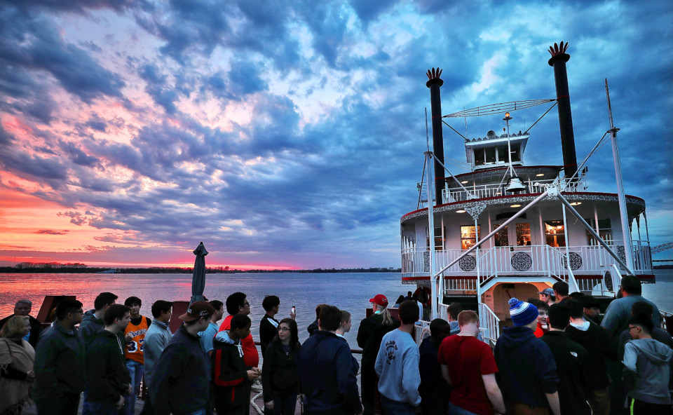 <strong>Folks wait to board a dinner cruise on the Memphis Queen III on March 29, 2019. The two-decked sternwheeler is part of the Memphis Riverboats Inc. fleet, which has been conducting tours on the Mississippi since the 1960s.</strong><span>&nbsp;(Jim Weber/Daily Memphian)</span>