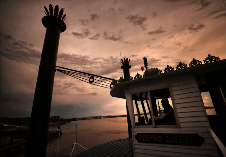 <strong>Pilot James Gilmer Sr. pulls away from Beale Street Landing during a dinner cruise aboard the Memphis Queen III on March 29, 2019. Memphis Riverboats Inc., which operates the two-deck sternwheeler, recently purchased the vacant Cargill dock on the Wolf River Harbor.</strong> (Jim Weber/Daily Memphian)