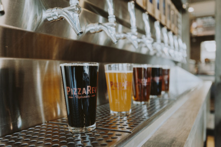 "<strong>The ""beer wall"" at PizzaRev.&nbsp;</strong>(Houston Cofield/Daily Memphian)"