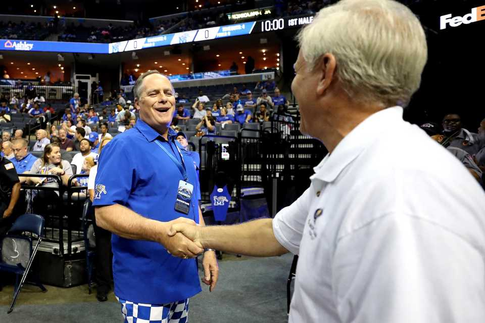<strong>University of Memphis President M. David Rudd (left) greets a Tiger fan at Memphis Madness at FedExForum on Thursday, Oct. 4.</strong> (Houston Cofield/Daily Memphian)