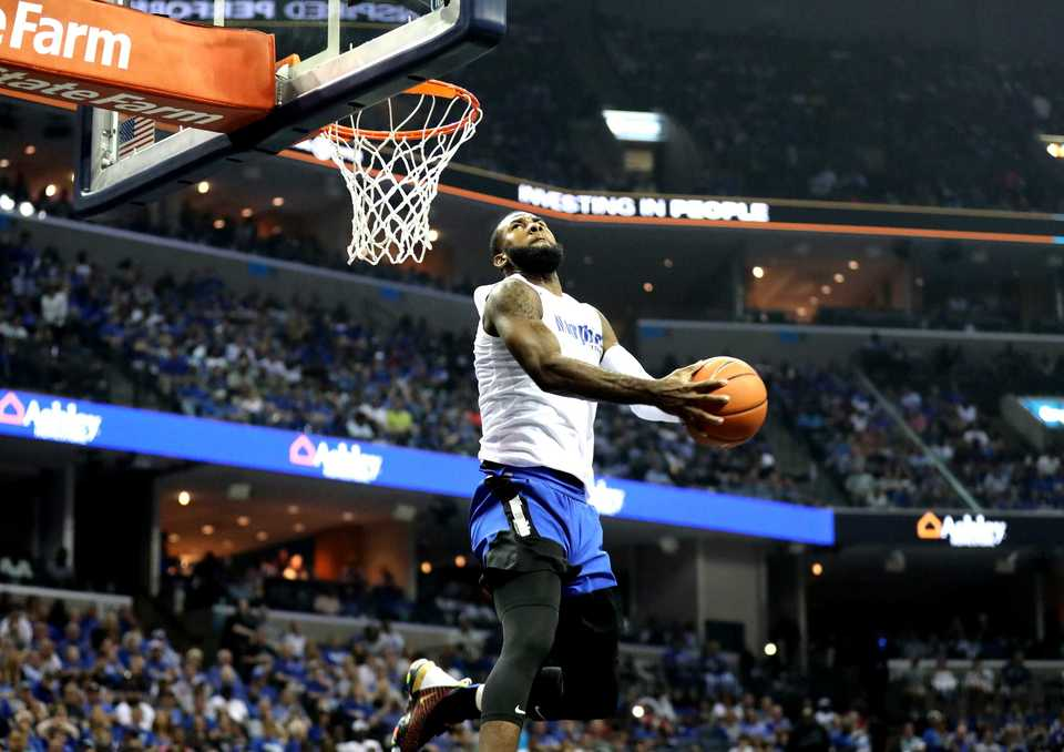 <strong>Forward Raynere Thornton dunks during the Memphis Madness dunk contest at FedExForum.</strong> (Houston Cofield/Daily Memphian)