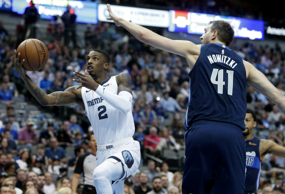 <span><strong>Memphis Grizzlies guard Delon Wright (2) drives past Dallas Mavericks forward Dirk Nowitzki (41) during the first half of an NBA basketball game in Dallas, Friday, April 5, 2019.</strong> (AP Photo/LM Otero)</span>