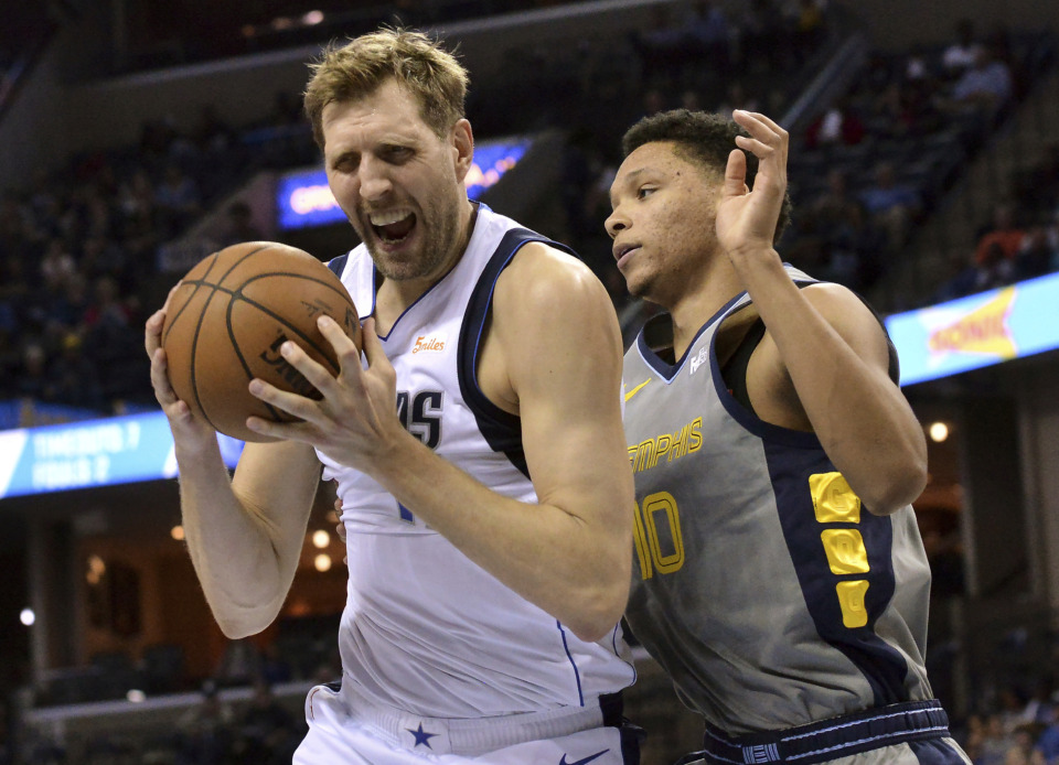 <span><strong>Dallas Mavericks forward Dirk Nowitzki (41) grabs a rebound against Memphis Grizzlies forward Ivan Rabb (10) in the first half an NBA basketball game Sunday, April 7, 2019, in Memphis, Tenn.</strong> (AP Photo/Brandon Dill)</span>