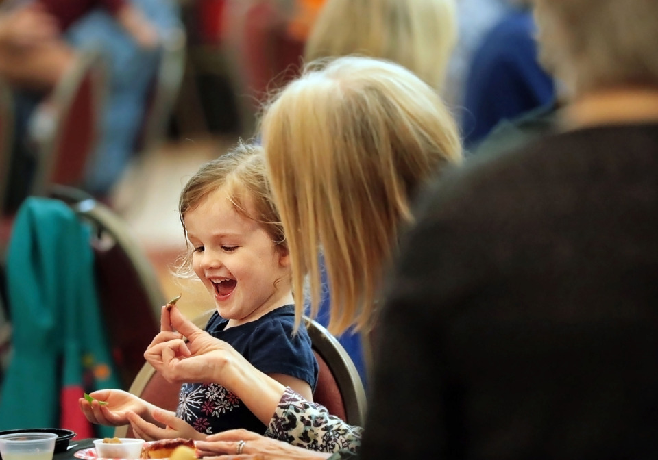 <strong>Reba Burgess samples foods with her granddaughter Hailey Huckelberry, 4, during Arlington's annual Taste of Arlington at Arlington High School on Sunday, April 7. The event, which highlights offerings from Memphis-area restaurants, caterers and wholesalers, featured food samples, live music and a silent auction.</strong> (Jim Weber/Daily Memphian)