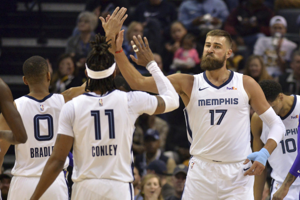 <span><strong>Memphis Grizzlies center Jonas Valanciunas (17) and guard Mike Conley (11) high-five in the first half of an NBA basketball game against the Los Angeles Lakers Monday, Feb. 25, 2019, in Memphis, Tenn.</strong> (AP Photo/Brandon Dill)</span>