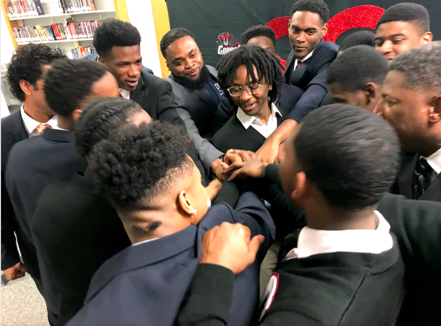 <strong>Members of the Brothers &amp; Sisters Speaking Out For Change and their mentors huddle after presenting their recommendations to Shelby County Schools leaders.</strong> (Laura Faith Kebede/Chalkbeat)