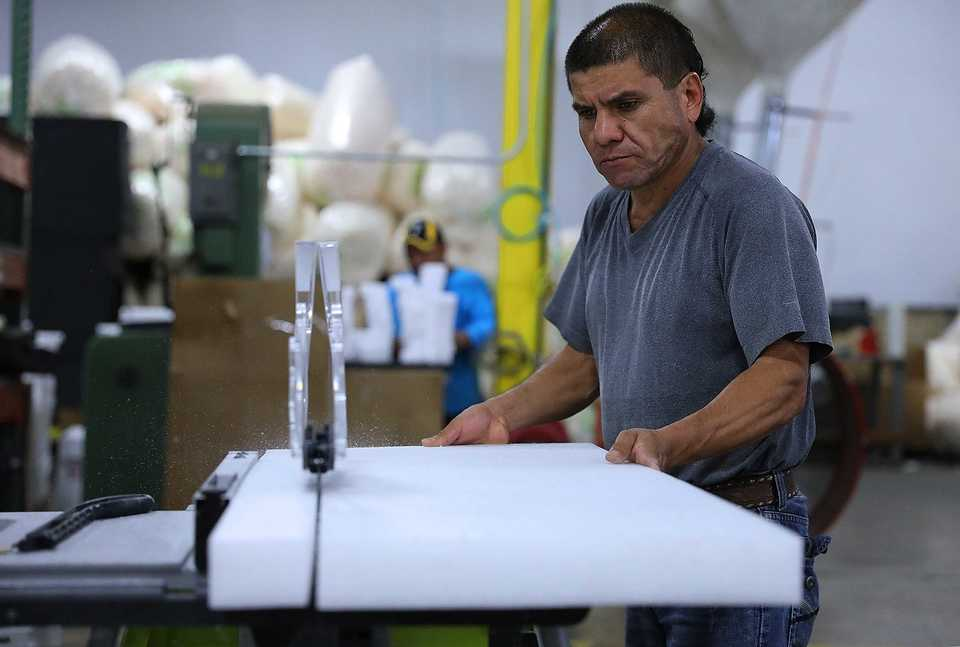 <strong>Manuel Llamas cuts a sheet of foam packing material into smaller strips at GLS Integrated on Thursday Oct. 4. After only six months of operations, GLS is preparing to more than double its current space at 4841 Cromwell Ave.</strong> <strong>in Memphis' southeast industrial district.</strong> (Patrick Lantrip/Daily Memphian)