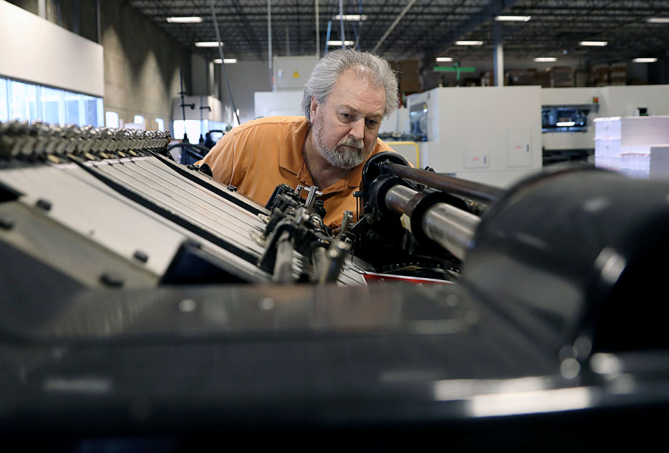 <strong>Alan Harsson works on pressing a sheet of defraction glasses at American Paper Optics&rsquo; Bartlett headquarters on Tuesday, April 9. The company, which sold 45 million protective glasses for the Aug. 21, 2017, solar eclipse, has been preparing the past 18 months for the next big one that will cross South America, on July 2.</strong>&nbsp;(Patrick Lantrip/Daily Memphian)