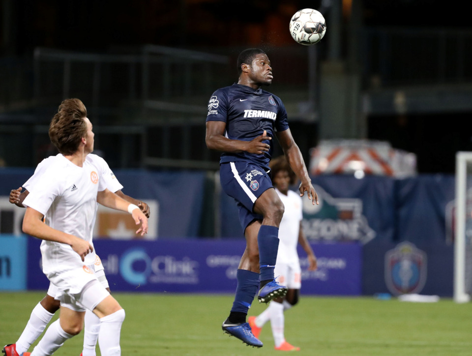 <strong>Memphis 901 FC midfielder Ewan Grandison (17) jumps for a header during a match against Atlanta United 2 on Wednesday, April 10, 2019.</strong> (Houston Cofield/Daily Memphian)